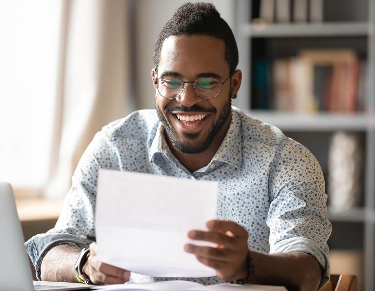 joyful guy reading off paper
